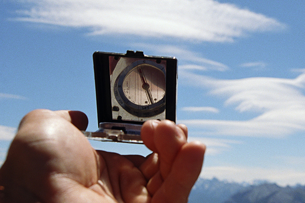 Canadian Rockies, man holding compass, close-up of hands